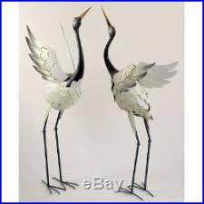 crane statue sculpture garden bird