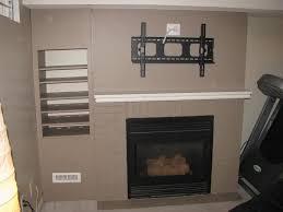 hiding tv above fireplace dubious image