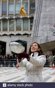 Guildhall, London, UK 25 Feb 2020 - The Lady Mayoress Hilary Russell flips  a pancake before the start of the annual Inter-Livery Pancake Race on  Shrove Tuesday at The Guildhall. Participants from