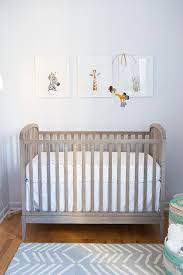 wood and lucite nursery crib with