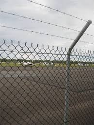 Commercial Security Fence Has A Cranked Top With 3 Rows Of Barbed Wire For Added Security Fence Security Fence Wire Fence