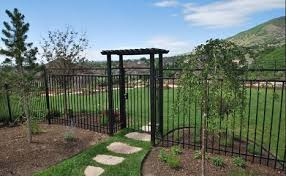 Tall Metal Fence And Gate With Arbor Fence Landscaping Garden Fencing Backyard Fences