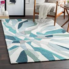 hand tufted carved teal blue area rug