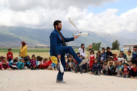 Clay, one of the members of Clowns Without Borders, entertain Syrian  refugee children in Jab Janine, West Bekaa