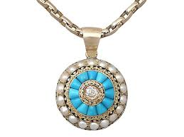 pendant with diamond pearl and enamel