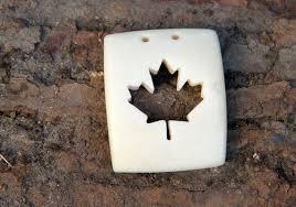 hand carved bone maple leaf pendant