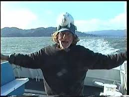 Lonnie Campbell and a rabbit on his head are dancing on a boat ...