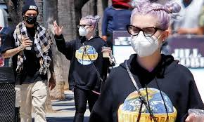 Kelly Osbourne and a male friend exit ...