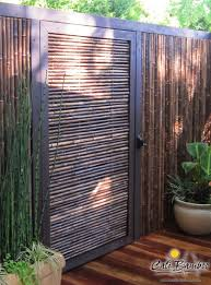 Black Bamboo Fence With Gate Cali Bamboo Fence Design Privacy Fence Designs Backyard Fences