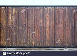 Wooden Garage Door Exterior Of Modern Home Background Giant Gate Fencing With Wood And Iron Slice With Wheel In Loft Style Stock Photo Alamy