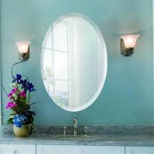 oval frameless wall mirror with beveled