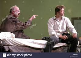 l to r) Chris Merritt as Mephistopheles and Rodney Gilfry as Faust ...