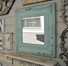 framed antique tin ceiling tile mirror