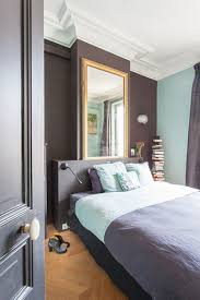 large mirror above bed in two tone