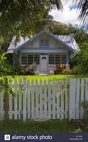 A Brightly Painted Small Wooden House With A White Picket Fence In Stock Photo Alamy