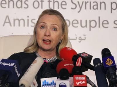 """Resultado de imagem para A Secretária de Estado dos EUA, Hillary Clinton, organiza a primeira Conferência de Amigos da Síria em Túnis. Aí, ela denuncia a China e a Rússia que «se imiscuem frente às aspirações do povo sírio»."""""""