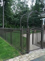 This Is Such A Beautiful And Elegant Fence With Imperial Finials And An Arbor Was Used To Accent The Entryway Jerith A Fencing Companies Garden Arch Fence