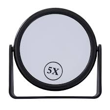 large magnifying mirror on stand