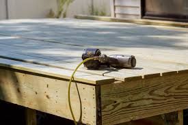 worker installing wooden floor air nail