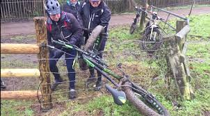 Watch These Cyclists Attempt To Rescue A Bike From An Electric Fence Bicycling