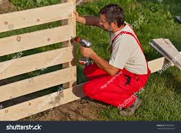 Man Building Wooden Fence Fastening Boards Miscellaneous Stock Image 387925681