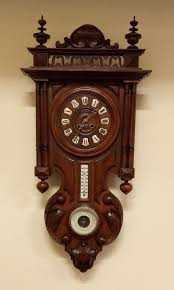 attractive walnut wall clock with