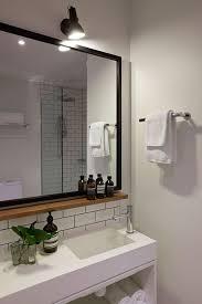 small wood shelf under mirror has