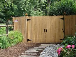 6 Foot Wood Privacy Fence Stockade Style With Double Gates Fence Landscaping Natural Fence Backyard Fences