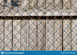 The Weathered Old Gray Wooden Fence Is Closed By A Rusted Netting Netting Stock Photo Image Of Nails Horizontal 168018192