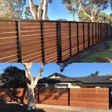 Merbau On Satin Black Steel Frames Never Gets Old Timber On Steel Satinblack Powdercoating Steel Fa Small Garden Design Black Steel Frame Sliding Gate