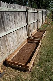 raised beds against fence this is