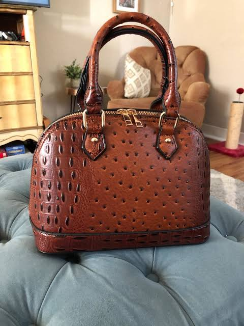 Image result for A small zip-around dome satchel