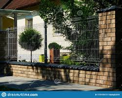 Light Metal Mesh Fence With Brick Pier Well Kept Front Garden Stock Image Image Of Light Exterior 173147015