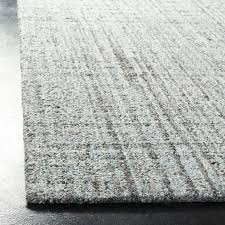 hand tufted blue black area rug