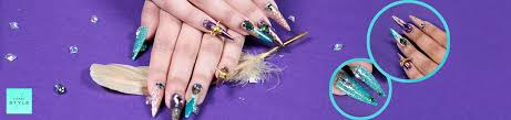 these beautiful jewel and feather nails