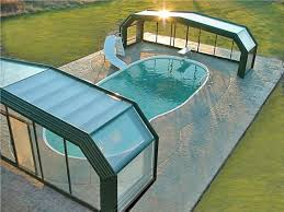 Roll A Cover Is America S Leading Custom Retractable Pool Enclosure Manufacturer Made In The U S A Cool Pools Pool Shade Indoor Swimming Pools