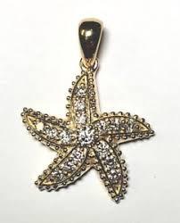 18k gold star fish diamond pendant