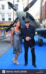 Brenda Johnson and Brian Johnson attending the premiere of Spitfire, held  at the Curzon Mayfair, London Stock Photo - Alamy