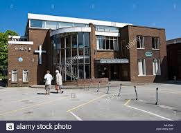 Women going into the Wesley church in West Bromwich Stock Photo - Alamy
