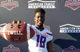 Four-star OLB Adrian Jackson receives Under Armour All-American jersey