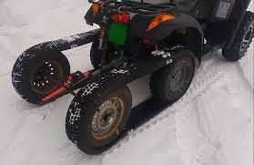 atv half track made of old snow tires