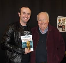 Superfan Aaron Price with veteran actor Shane Rimmer at Def-Con.    CapedWonder Superman Imagery