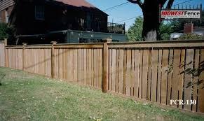 Capped Rail Wood Picket Fences Capped Rail Wood Picket Fences Provide Stylish Semi Privacy With Alternating Widt Wood Picket Fence Picket Fence Backyard Fences