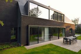 this contemporary black brick house was