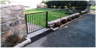 stone wall wrought iron railing fence