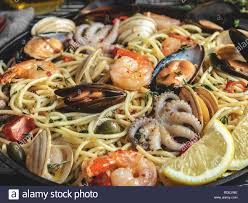 Cooked pasta with clams, shrimps, baby ...