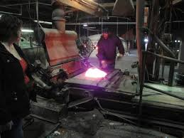 mixing the melted glass into batches