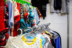 Children Clothes On Hangers In A Room Wardrobe With Boys Clothes On Hangers Shopping And Consumerism Concept Dressing Closet With Clothes Arranged On Hangerscolorful Wardrobe For Kids Stock Photo Download Image