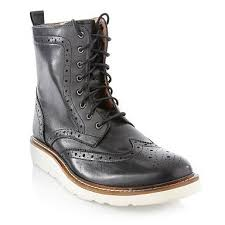 black brogue boots with white soles