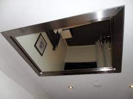 large mirror on the ceiling overlooking